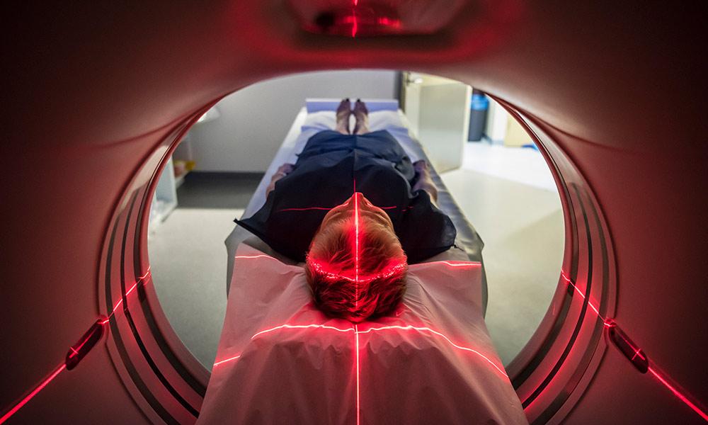 patient laying down in MRI brain scan machine