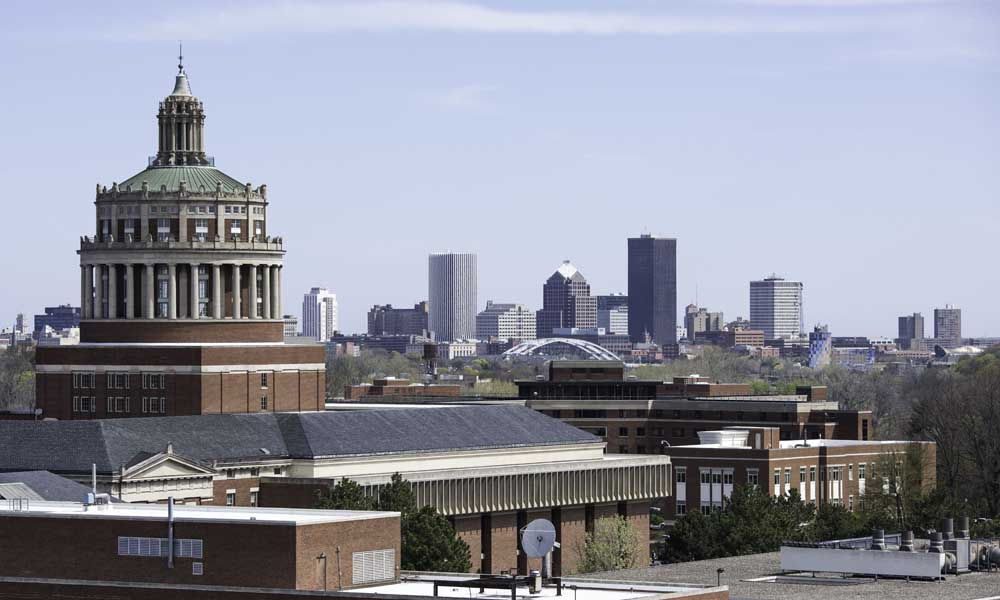 Rush Rhees Library with the city skyline in the background
