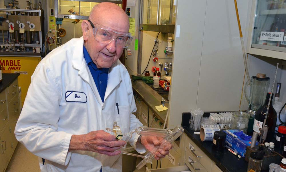 Donald Batesky holds test tubes in the lab