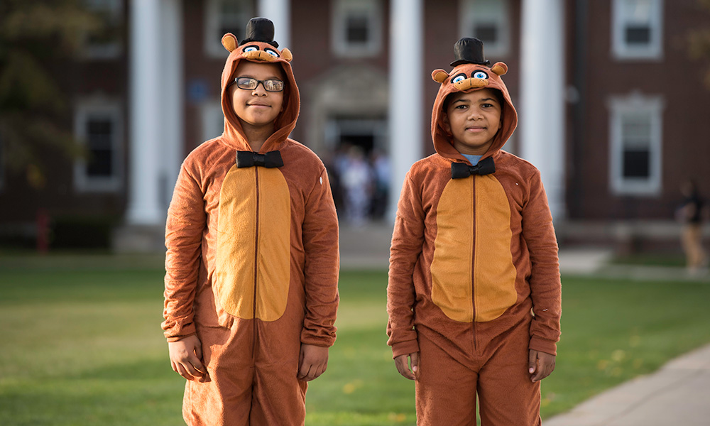 two kids dressed in Halloween costumes
