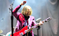 Tom Petty playing guitar