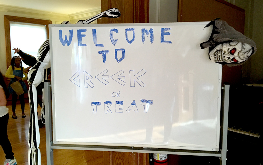 sign reads WELCOME TO GREEK OR TREAT