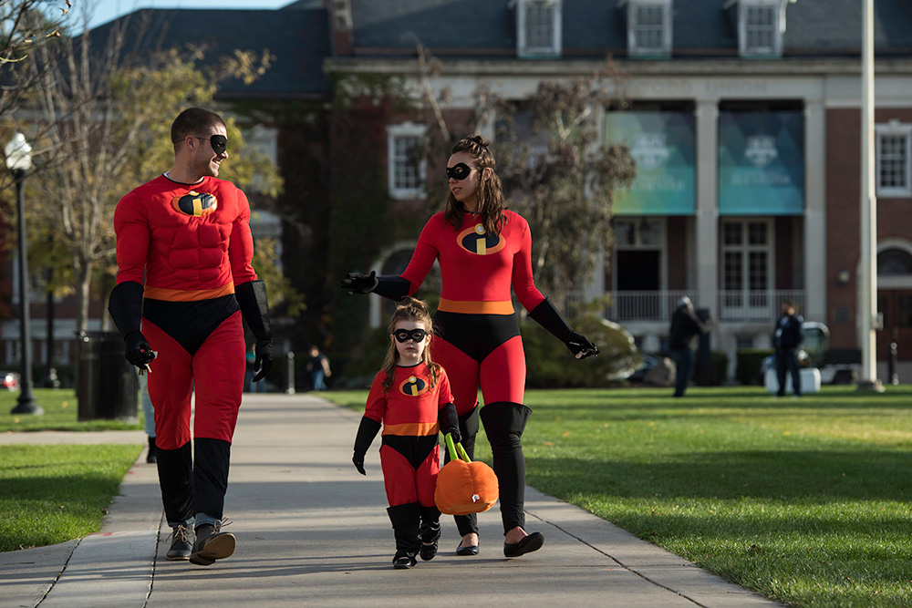 three people dressed as The Incredibles characters