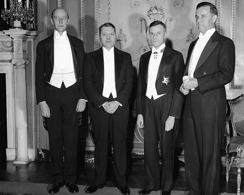 four men in tuxedos