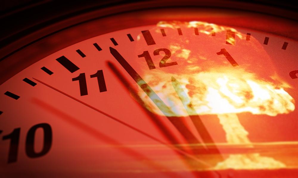 a clock face with a nuclear mushroom cloud