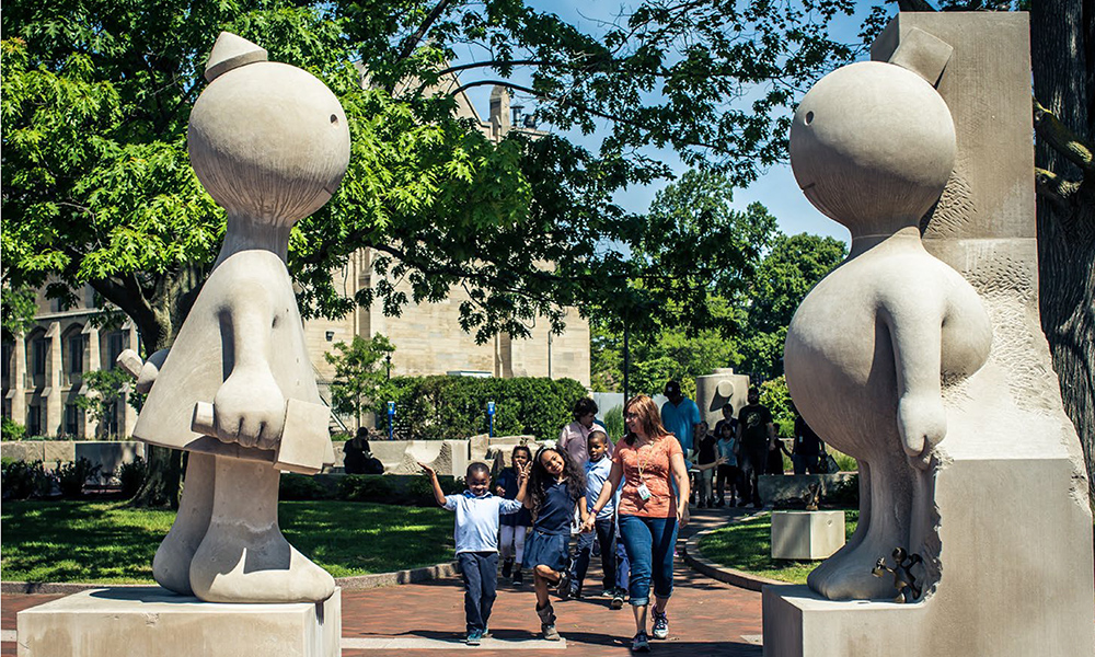 group of school kids go playing the MAG sculpture garden