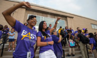 staff and teachers cheer at East High as students arrive