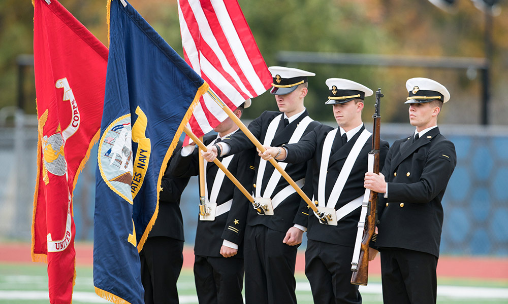 military color guard with American and service flags