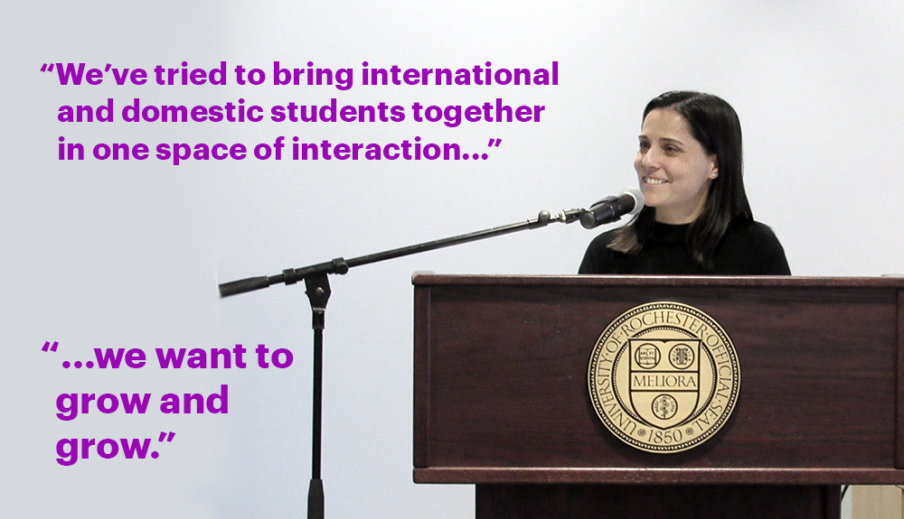 "Teresa Valdez behind a podium at the Language Center, with the words ""We've tried to bring international and domestic students together in one space of interaction ...We want to grow and grow."