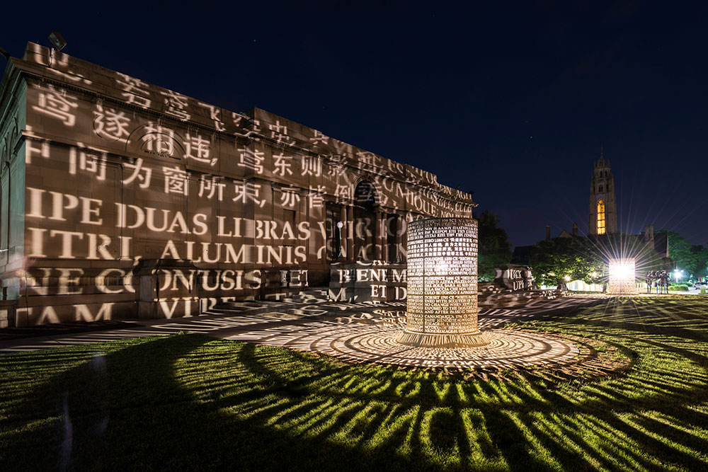 outdoor exhibit at Memorial Art Gallery, with words projected in light onto the building