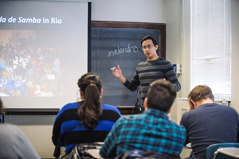 Pablo Sierra Silva teaching at the front of a classroom