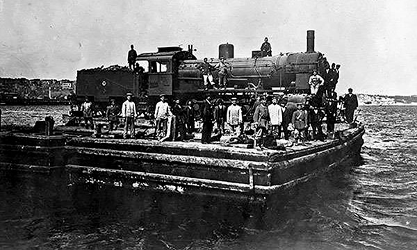historical photo of workers with a train