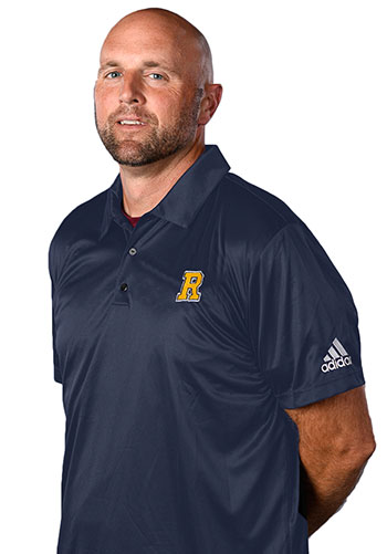 Man posing in a Rochester shirt