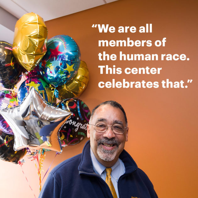 "photo of Paul Burgett also contains the quote, ""We are all members of the human race. This center celebrates that."""