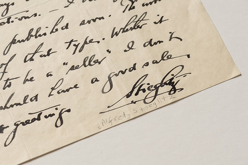 small fragment of handwriting with the signature A. STEIGLITZ