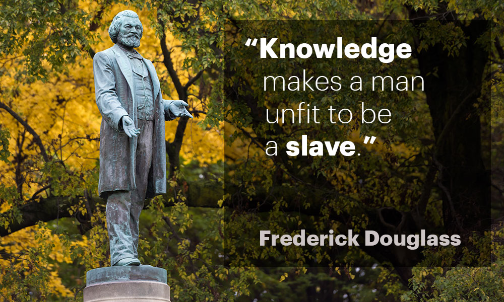 """photo of Frederick Douglass statue with the quote, """"Knowledge makes a man unfit to be a slave."""""""