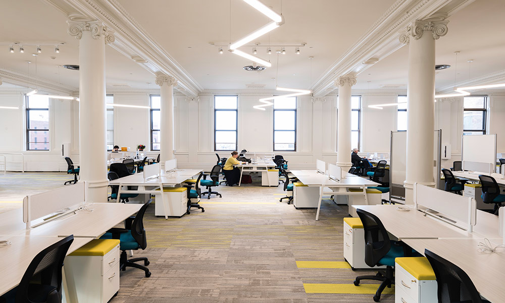 interior of the new NextCorp business incubator, with people sitting at desks using computers.