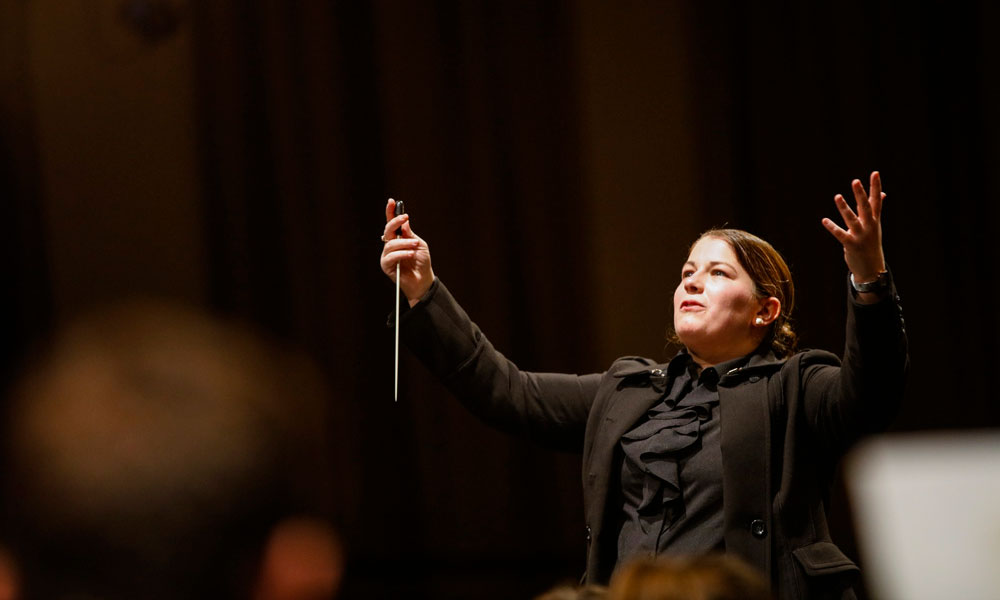 close-up photo of a conductor on stage