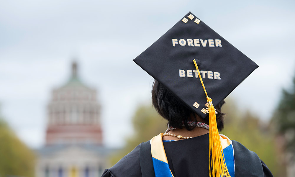 graduation cap reads FOREVER BETTER