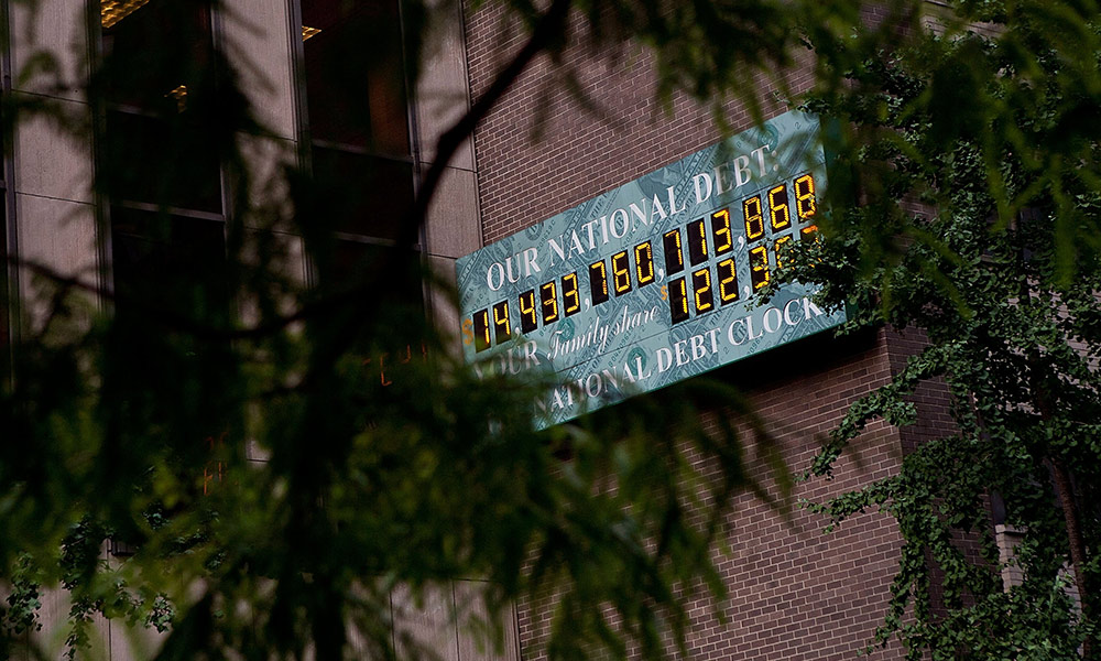 The lighted National Debt Clock sign reads $14 trillion