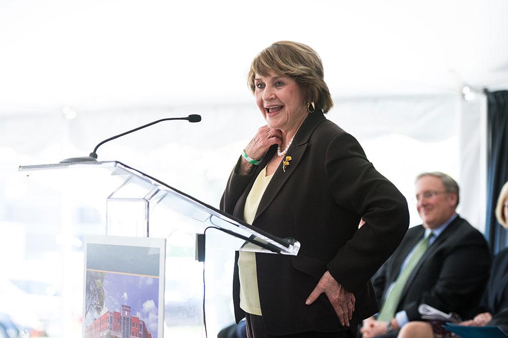 Louise Slaughter laughing at podium