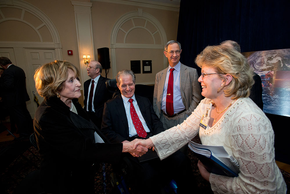 Louise Slaughter shaking hands in a crowd of people