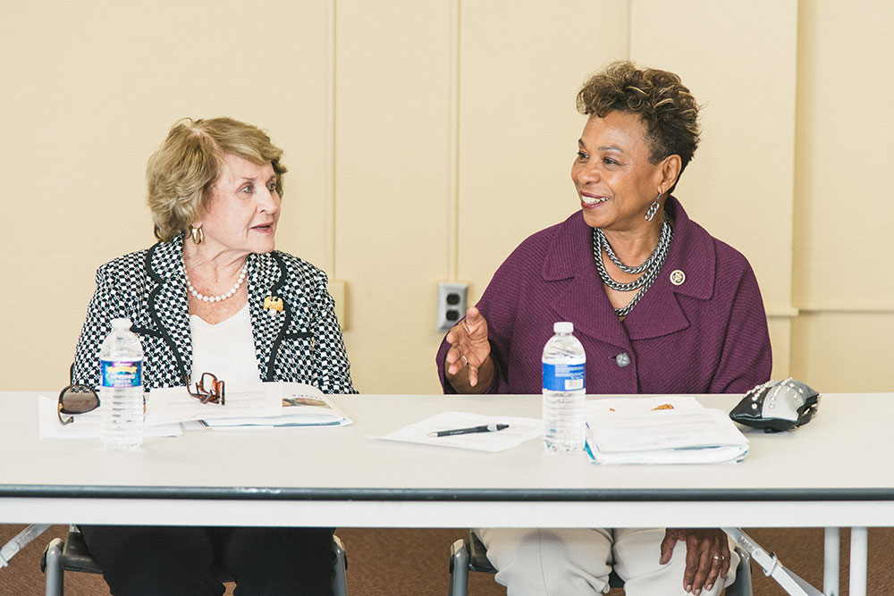 Louise Slaughter speaking at a table with Barbara Lee