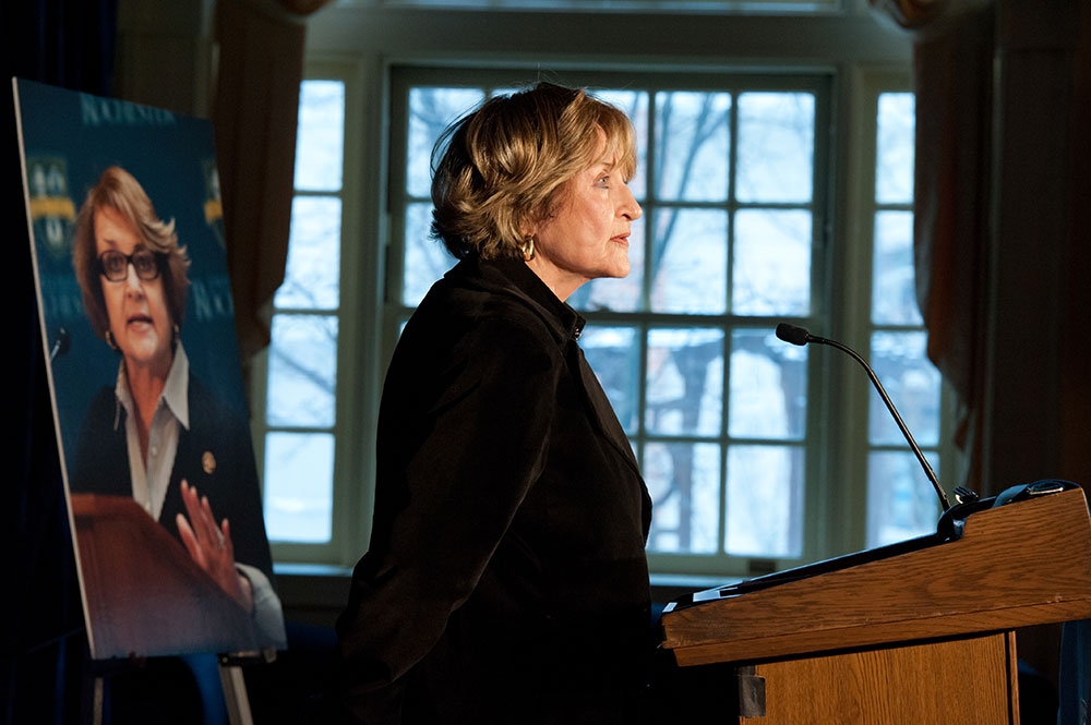 Louise Slaughter, in profile, in front of a window