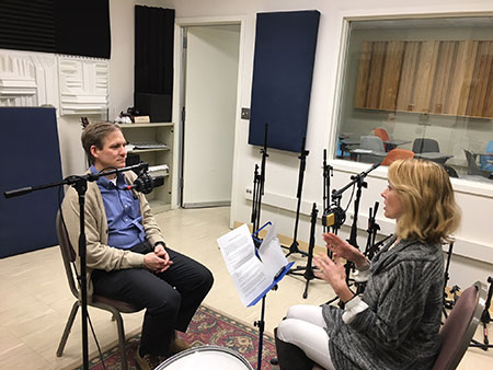 two people sitting in a recording studio