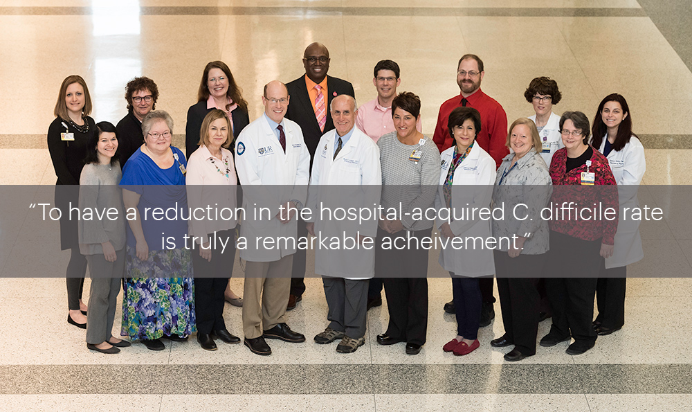 "group portrait with the quote, ""to have a reduction in the hospital-acquired C. difficile rate is truly a remarkable achievement."""