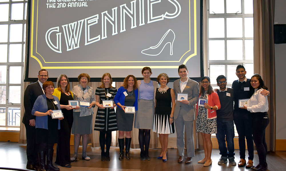 group portrait of award winners in front of a sign that reads 2ND ANNUAL GWENNIES