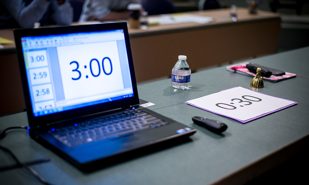 laptop on a desk with a countdown clock of three minutes on the screen