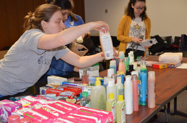 people sorting toiletries