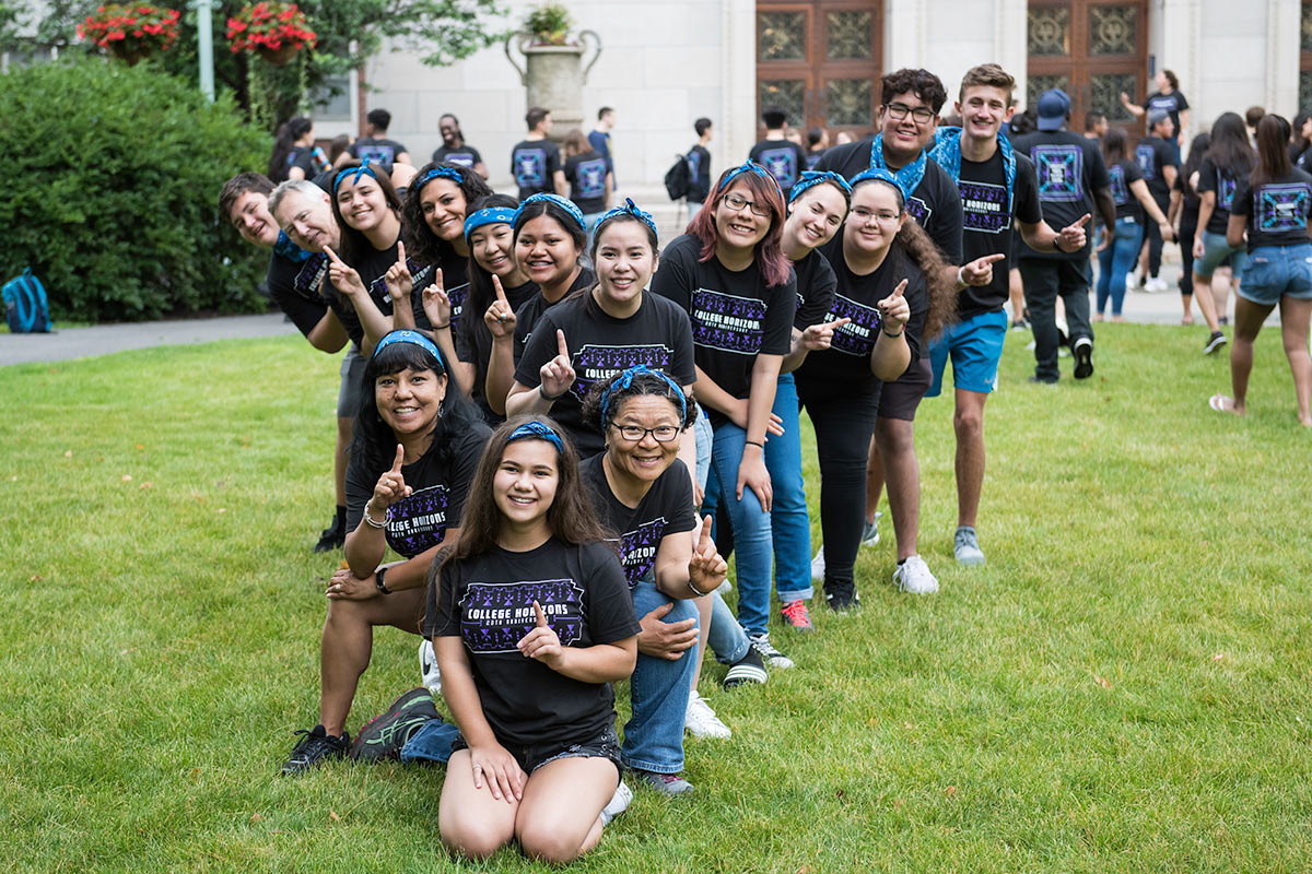 high school students in College Horizons shirts assemble on Eastman Quad