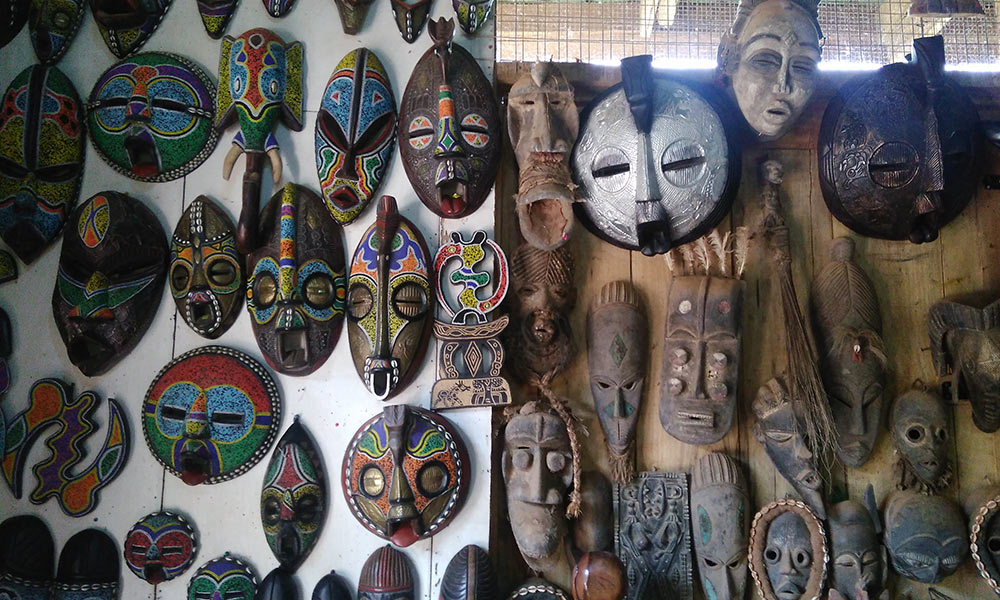 African masks hanging on a wall in Ghana