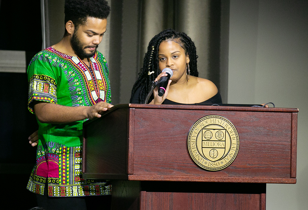 two students behind the podium