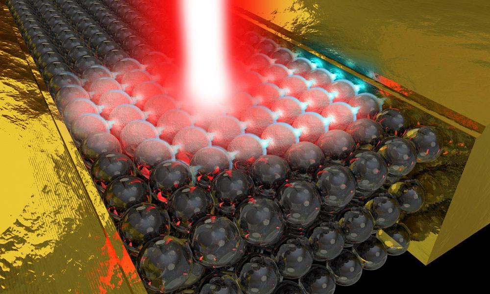 illustration of a laser pulse on glass-like beads