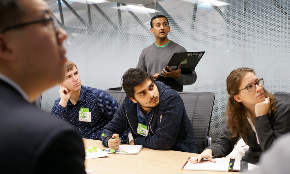 Nvidia staff give a presentation to Rochester students as part of a career exploration tour