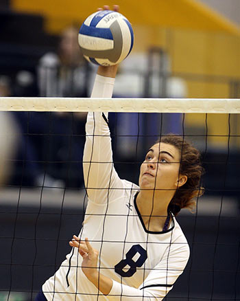 female volleyball player at the net