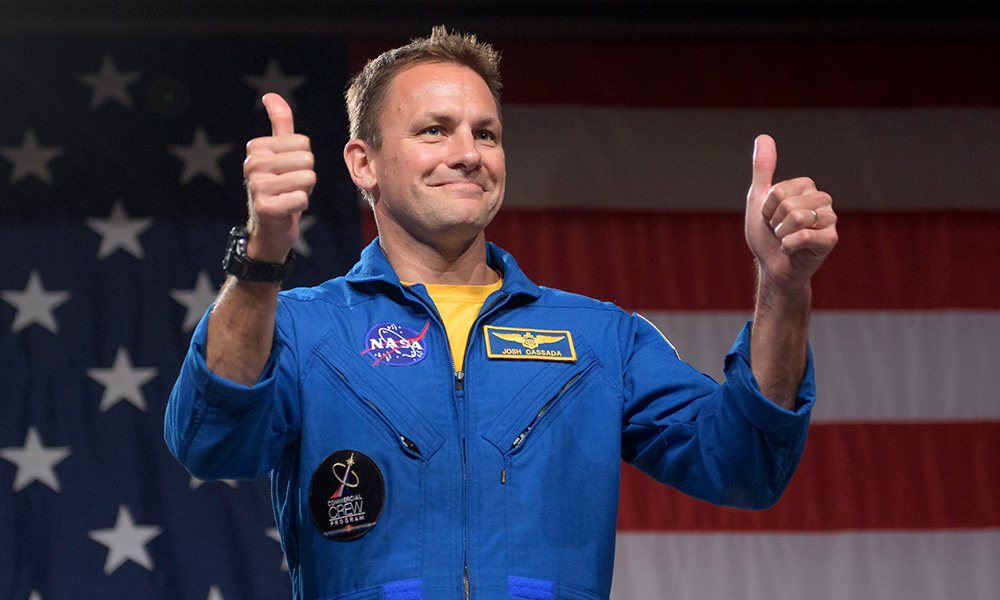 John Cassada, in astronaut uniform, giving a thumbs up