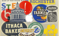 laptop covered in stickers for University of Rochester, Ithaca Bakery, other bands, etc.