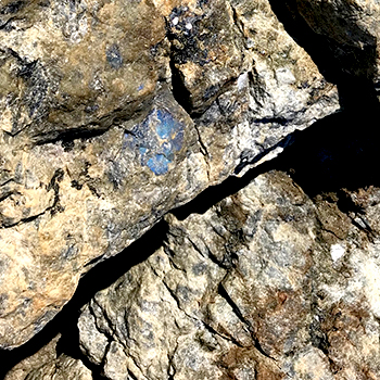 close-up of rocks with sparking blue crystals