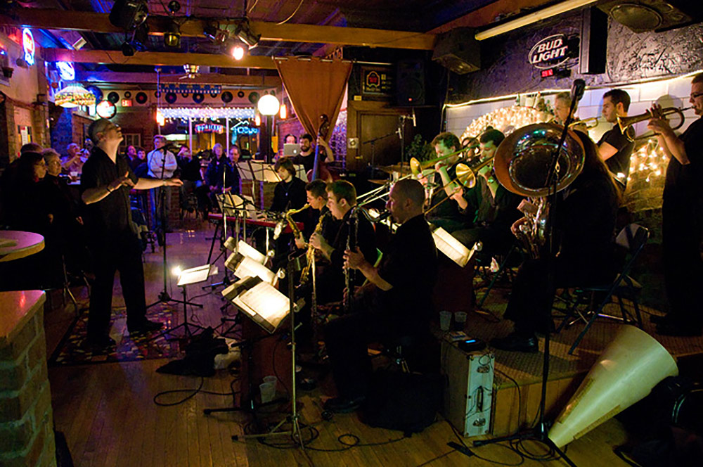 group of musicians performing in a bar