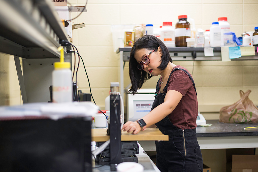 portrait of April Wang working in a lab