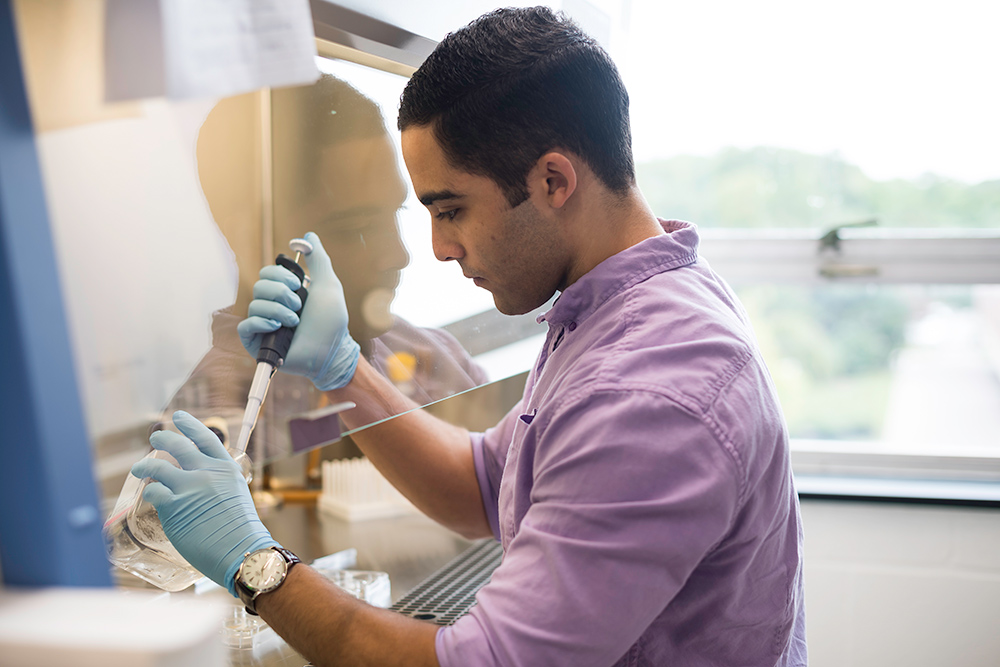 portait of Austin Skeeters working in a lab