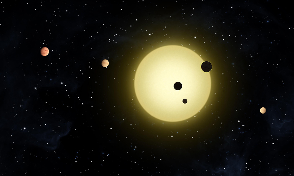 artist illutration of a compact soloar system with five planets around a central bright star