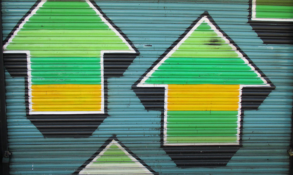 three arrows painted on a garage door