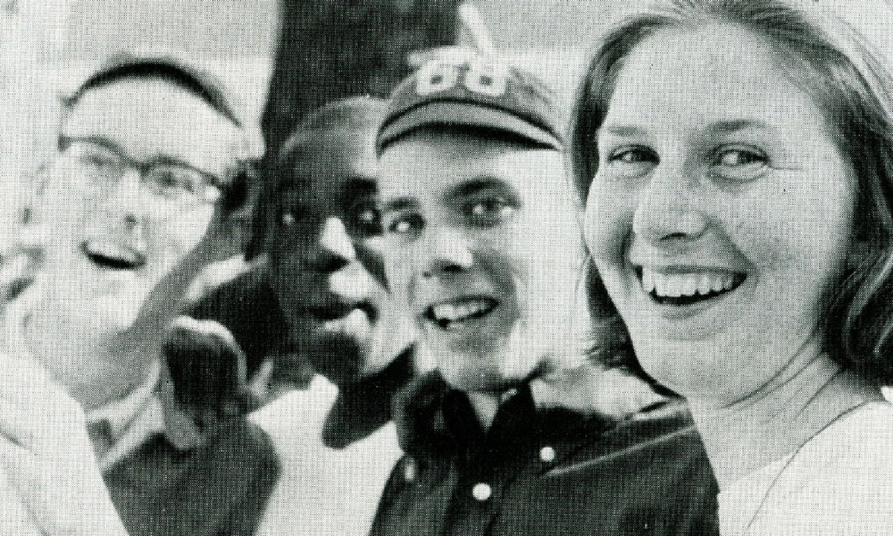 historical image: four students smiling, one wearing a bllcap with the year 68 on it