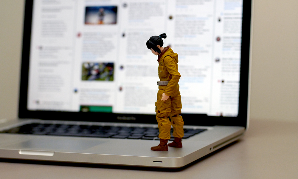 Star Wars Rose Tico action figure stands sadly on a computer keyboard