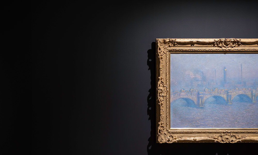 a painting of the Thames River by Claude Monet, part of the focus Monet exhibition at Memorial Art Gallery